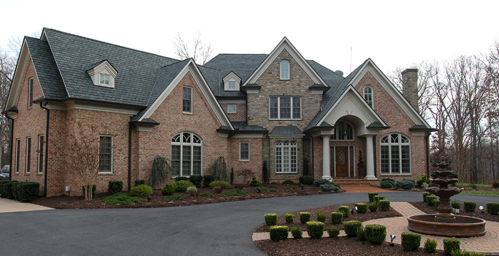 Estate style home with brick and stone exterior materials.