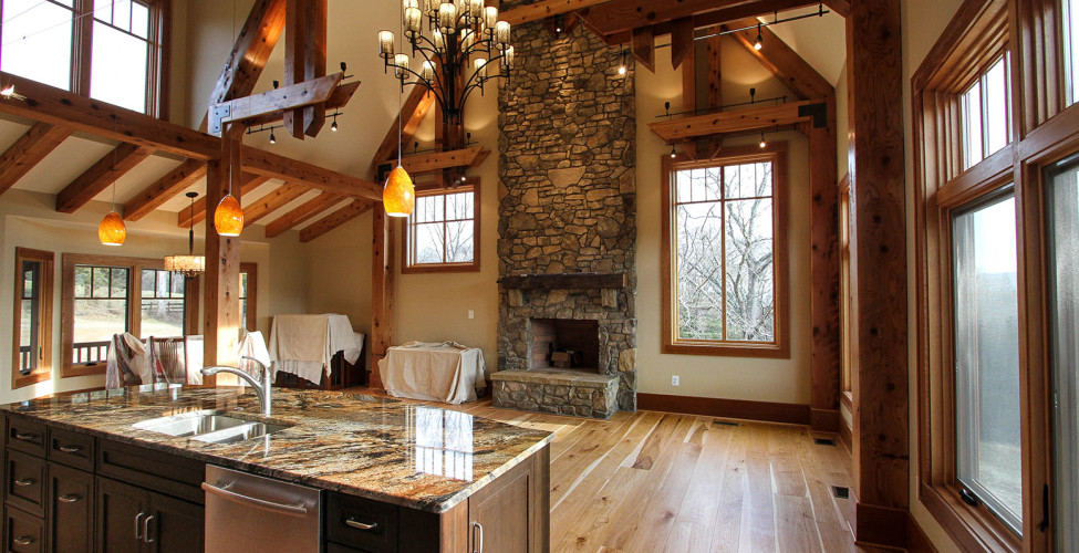 Stunning cedar post and beam interior details with stone masonry fireplace.
