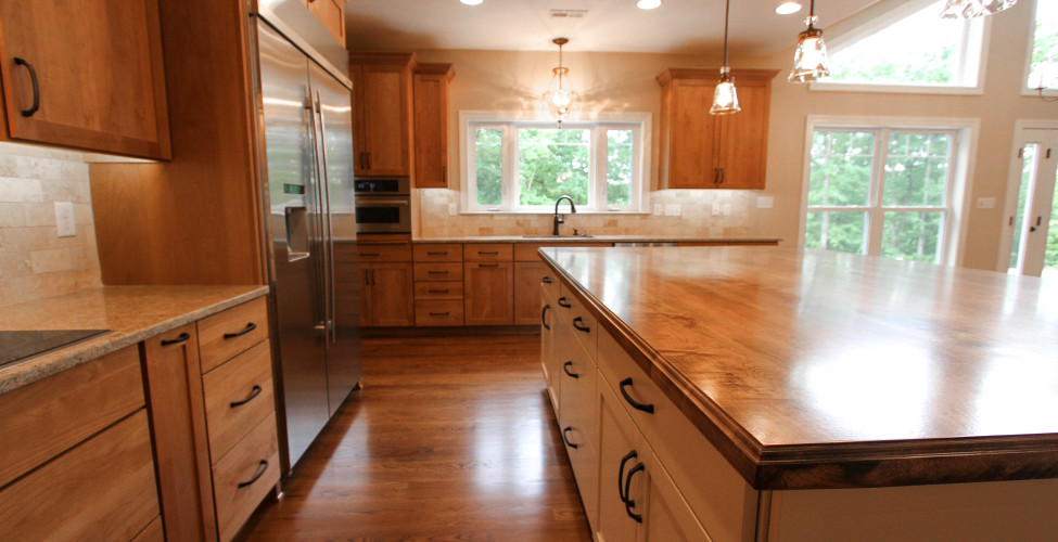 Oak flooring, hardwood center island top, shaker style cabinets and granite counter tops.