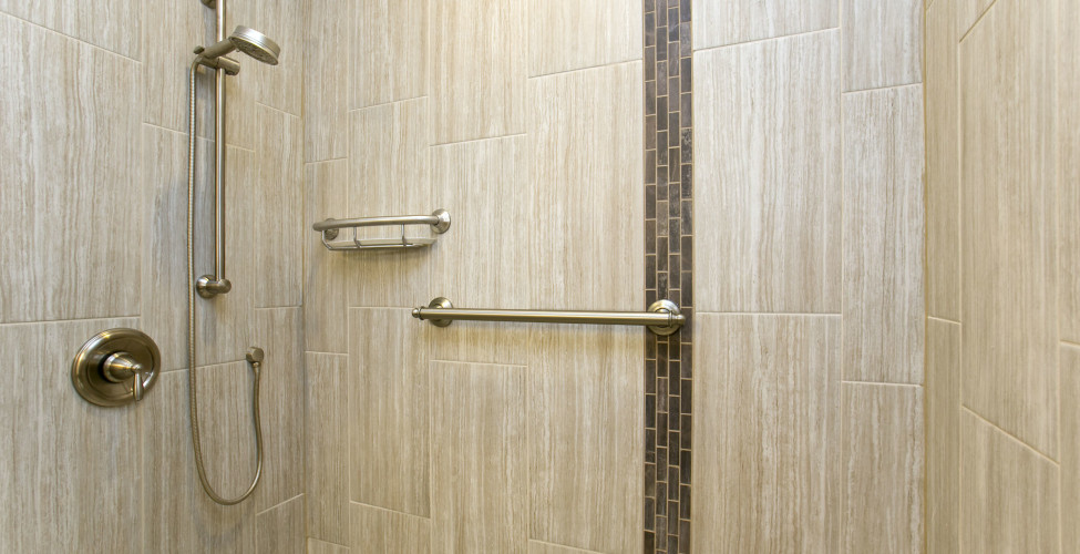 Creating a home and bathroom that truly expresses who you are is an art to behold. Grab bars were installed as well as a no threshold opening to allow for the future needs of the aging.