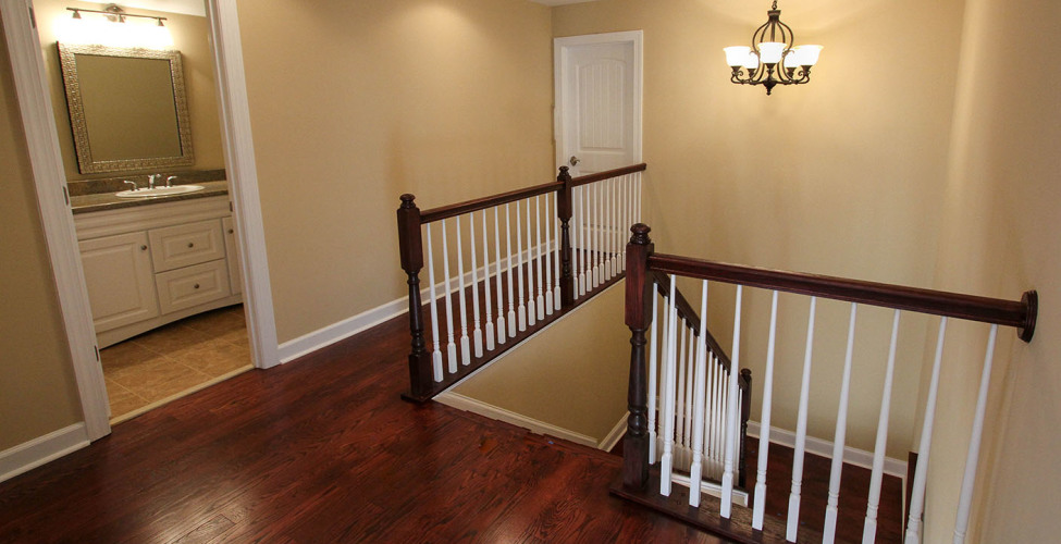Easy access to the kitchen area with this beautiful back stair.
