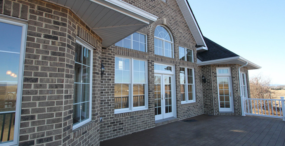 Windows bring in beautiful natural light as well as create balance and design.