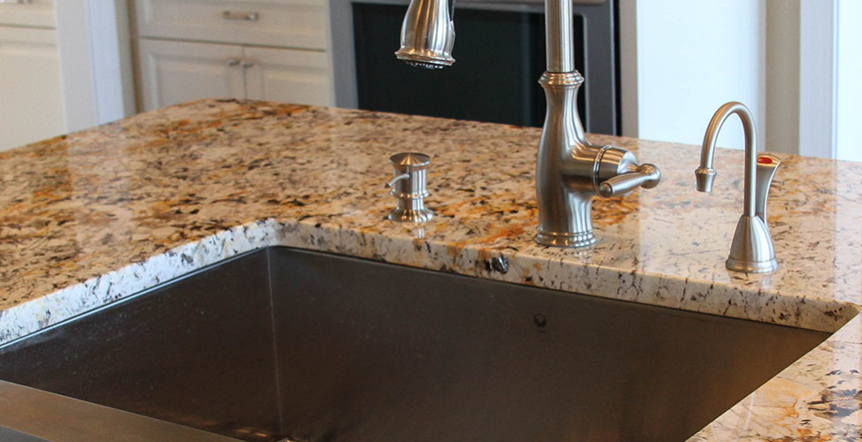 Stainless steel farm sink and matching faucet in brushed nickel.