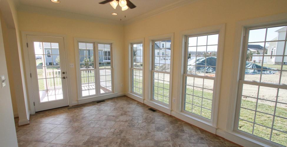 Willow first floor master best builder clarke county va for Sunroom flooring ideas