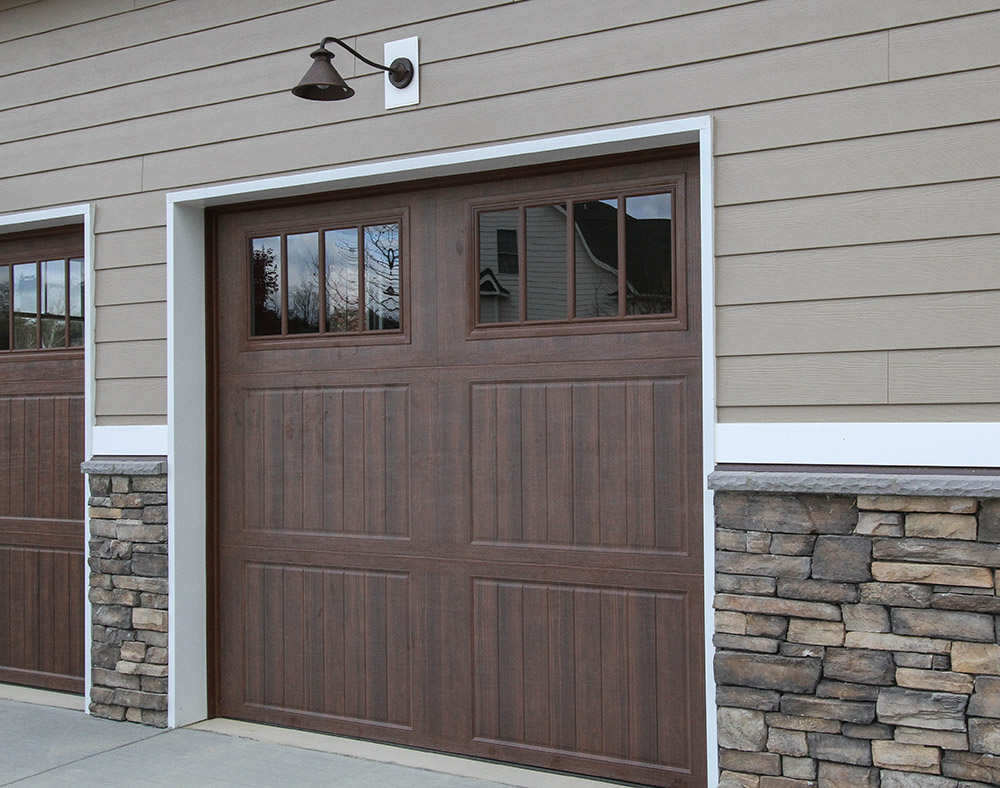 Exterior custom home photos from a trusted winchester builder for Wood grain garage doors