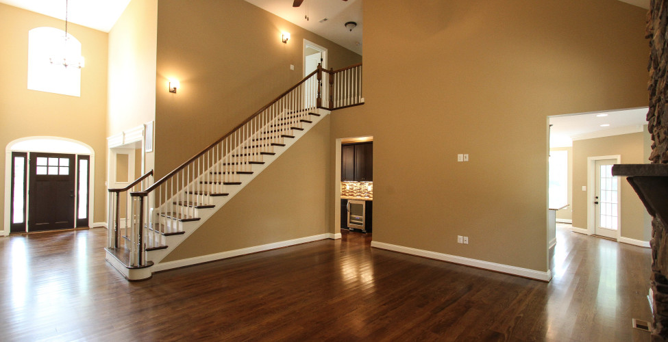 A spacious entertaining space with a staircase that boasts style and elegance.