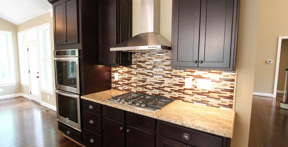 Gas Fireplace, Double Ovens, and Stainless steel range hood.