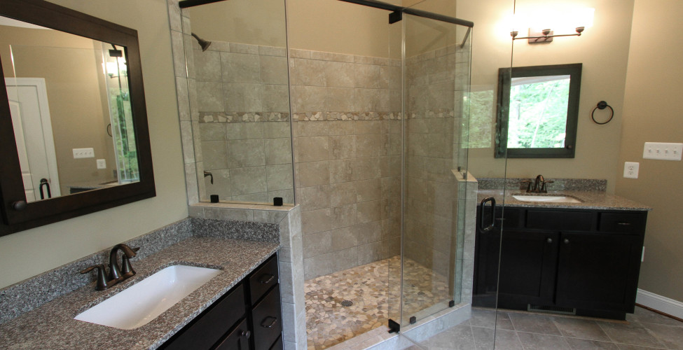 Dual vanities flank both sides of this stunning spacious shower.
