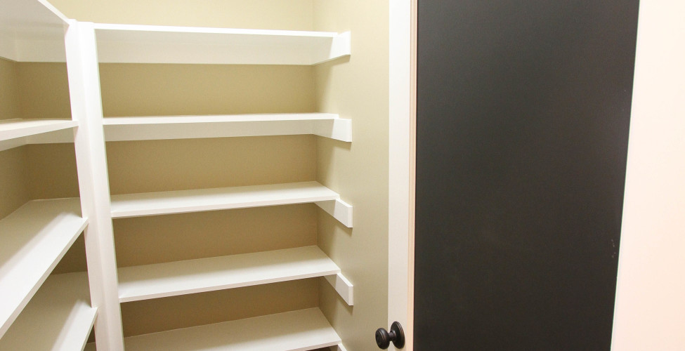 Walk in pantry with structurally sound shelving and caulk board door (optional)!