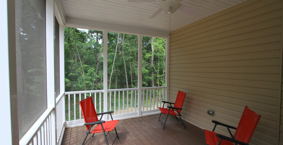 Low maintenance screened porch off the the kitchen and breakfast area.