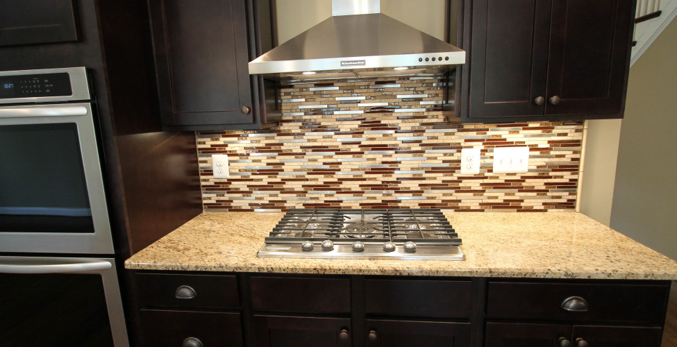 Gas Cook top, glass and stainless steel tile back splash, Expresso color cabinets.